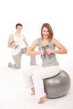 Young couple with weights and fitness ball Royalty Free Stock Photography