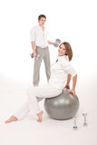 Young couple with weights and fitness ball Royalty Free Stock Images