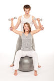 Young couple with weights, fitness ball on white Stock Image