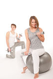 Young couple with weights,fitness ballon white Royalty Free Stock Photos