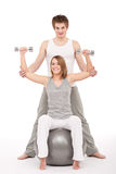 Young couple with weights on white Royalty Free Stock Photo