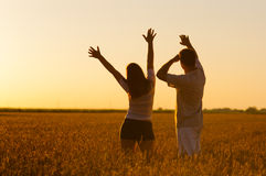Young couple in the wheat field on summer day Royalty Free Stock Images