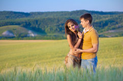 Young couple in wheat field Royalty Free Stock Image