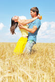 Young couple on wheat sunny field. Young couple on wheat field Royalty Free Stock Image