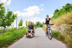 Young Couple In Wheelchair Enjoying Time Outdoors Royalty Free Stock Photos