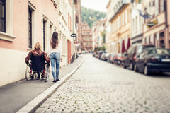 Young Couple In Wheelchair Strolling In The City Royalty Free Stock Images