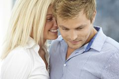 Young couple whispering Stock Image