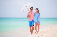Young couple on white beach Royalty Free Stock Photography