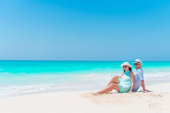 Young couple on white beach outdoors. Happy family enjoy their honeymoon. Young couple on white beach during summer vacation. Happy lovers enjoy their honeymoon Royalty Free Stock Image