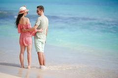 Young couple on white beach during summer vacation. Happy family enjoy their honeymoon stock images