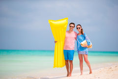 Young couple on white beach at summer vacation Royalty Free Stock Image