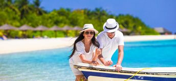 Young couple on white beach at summer vacation Royalty Free Stock Photo