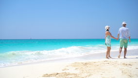 Young couple on white beach during summer vacation. Happy lovers enjoy their honeymoon. Young couple on white beach during summer vacation. Happy lovers enjoy stock video
