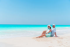 Young couple on white beach during summer vacation. Happy lovers enjoy their honeymoon. At exotic island Stock Image