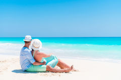 Young couple on white beach during summer vacation. Happy lovers enjoy their honeymoon. At exotic island Stock Photos
