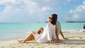 Young couple on white beach during summer vacation. Happy lovers enjoy their honeymoon at exotic island. Young couple on tropical beach with white sand and stock video footage