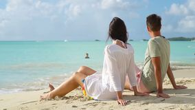 Young couple on white beach during summer vacation. Happy lovers enjoy their honeymoon at exotic island. Young couple on tropical beach with white sand and stock video