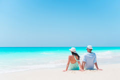 Young couple on white beach during summer vacation. Happy lovers enjoy their honeymoon. Family beach vacation. Young couple on white beach during summer vacation Stock Photos