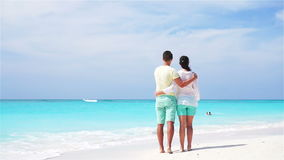 Young couple on white beach during summer vacation. Happy lovers enjoy their honeymoon. SLOW MOTION VIDEO. stock footage