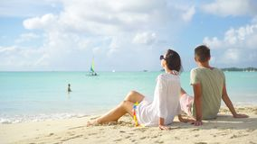 Young couple on white beach during summer vacation. Happy family enjoy their honeymoon stock footage