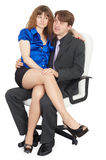 Young couple in white chair Stock Photos