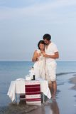 Young couple  in white clothes on the beach Stock Image