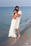 Young couple  in white clothes on the beach Royalty Free Stock Photo