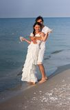 Young couple  in white clothes on the beach Royalty Free Stock Photography