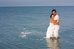 Young couple  in white clothes in the sea Royalty Free Stock Image