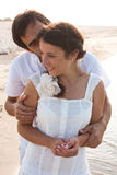 Young couple  in white clothes in the sea Stock Images