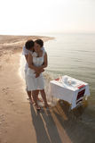 Young couple  in white clothes in the sea Royalty Free Stock Images