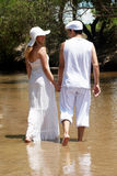 The young couple in white going on river Royalty Free Stock Image