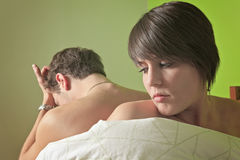 Young couple who having problem in bed Royalty Free Stock Photos