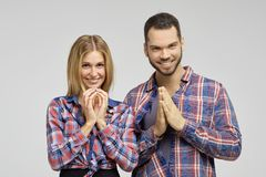 Young couple are widely and gratefully smiling. They are waiting for a miracle and gifts. Royalty Free Stock Photo