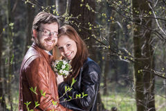 Young couple wih flowers Royalty Free Stock Photography