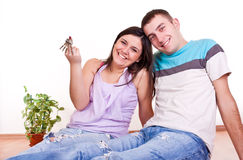 Young couple wiht keys in new apartment Royalty Free Stock Photos