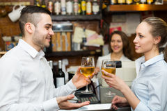 Young couple with wine at bar Royalty Free Stock Photography