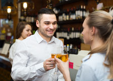 Young couple with wine at bar Royalty Free Stock Images