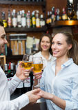 Young couple with wine at bar Stock Photos