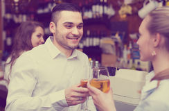 Young couple with wine at bar stock photo