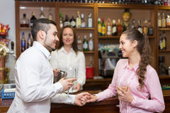 Young couple with wine at bar Royalty Free Stock Image