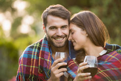 Young couple with wine wrapped in blanket. At park royalty free stock photos