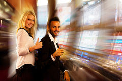 Young couple winning on slot machine in casino Royalty Free Stock Photo