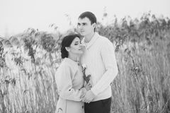 Young couple in a winter field Stock Image