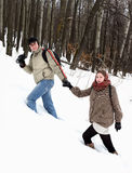 A young couple in the winter forest Stock Photos
