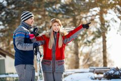 Couple on winter holiday looking something in distance Stock Images