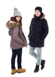 Young couple in winter jackets isolated on white Royalty Free Stock Photography