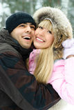 Young couple in winter park Stock Photo