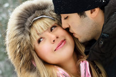 Young couple in winter park Stock Image