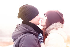 Young couple winter park, forest, kissing, love each other, happy family, idea style concept relationships, in  clothes Stock Photos